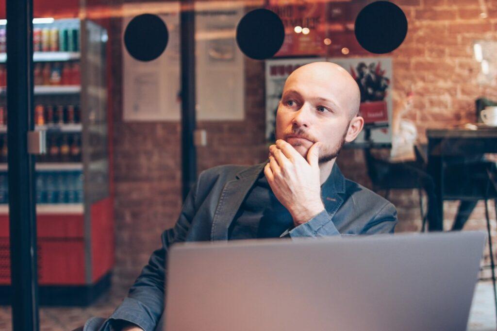 man thinking about a marketing budget