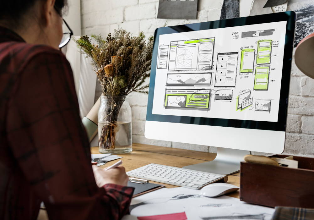 man designing a wireframe for a website